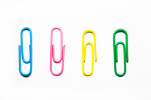 Multicolored Paper Clips On A White Background Close-up