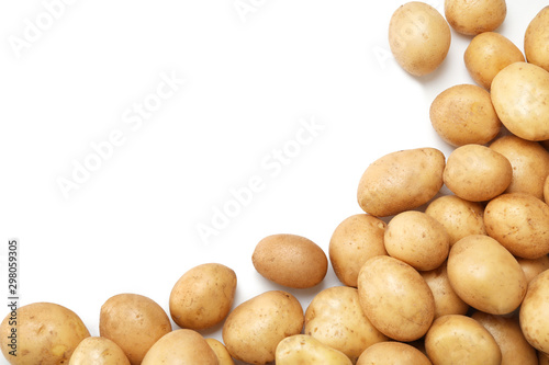 Wallpaper Mural Raw fresh organic potatoes on white background, top view
