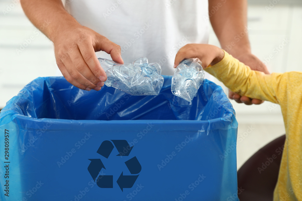 Fototapety, obrazy: Father and son sorting garbage in kitchen, closeup. Recycling concept