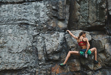 Attractive Slim Muscular Young Woman Rockclimber Climbing On Tough Sport Route, Resting And Chalking Hands.