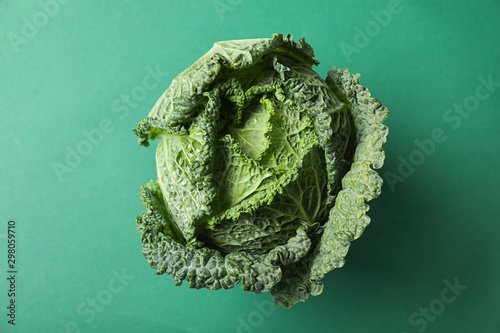 Obraz Fresh savoy cabbage on green background, top view - fototapety do salonu