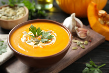 Delicious Pumpkin Soup In Bowl On Wooden Table