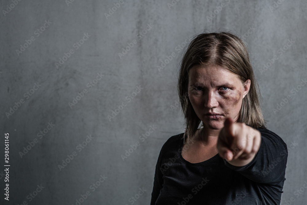 Fototapety, obrazy: Portrait of a woman victim of domestic violence and abuse which pointing finger at you. Empty space for text