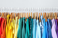 Rack With Bright Clothes On Li...