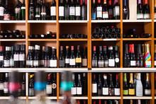 Rows Of Wine Bottles On Shelve...