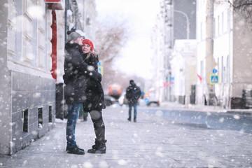 Young couple walking throug...