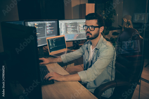 Photo of serious man employed to work as a system administrator solving client p Wallpaper Mural