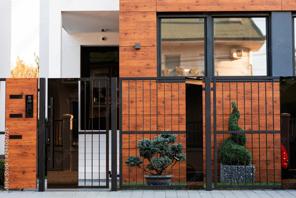 Fototapeta Safety gate and exterior on a modern house.