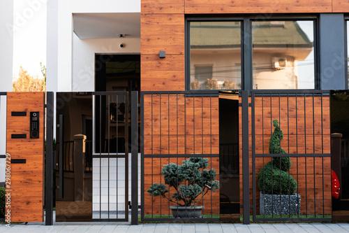 Obraz Safety gate and exterior on a modern house. - fototapety do salonu