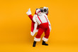 canvas print picture Full length photo of funny fat santa claus hipster with big belly hold boombox have fun listen christmas carols celebrate x-mas noel party wear red hat headwear boots isolated yellow color background