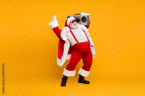 Full length photo of funny fat santa claus hipster with big belly hold boombox h Fototapeta