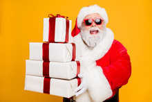 Portrait Of Funny Funky Grey Hair Santa Claus In Red Hat Hold Packages He Brings For Good Kids People Celebrate Newyear Holly Christmas Time Isolated Over Yellow Color Background