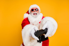 Portrait Of Funny Funky Crazy Christmas Father Having X-mas Newyear Celebration Play Magic Videogame Use Joy Stick Feel Crazy Wearing White Gloves Isolated Over Bright Color Background