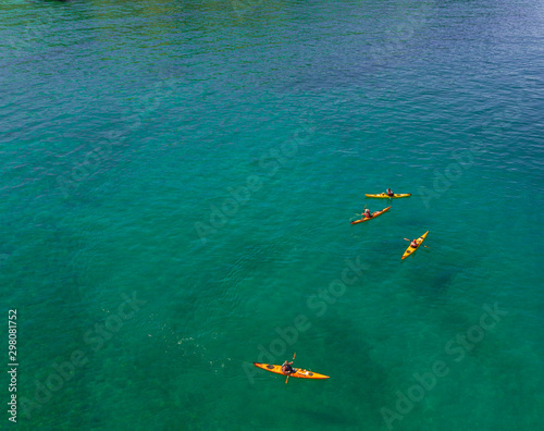 Valokuva Bay with transparent beach with kayakers