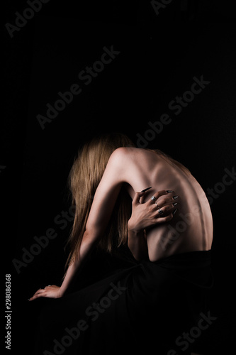 A girl with a bare back, severe thinness and protruding ribs Wallpaper Mural