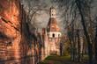 Leinwandbild Motiv Half ruined brick wall and Solevaya tower of Simonov Monastery, Zamoskvorechye District, Moscow, Russia