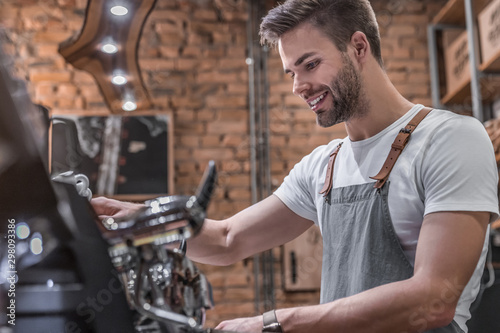 Side view shot of a male barista making a cup of coffee Canvas Print