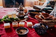 Set Of Traditional Arab Dessert And Tray With Teapot And Cups Placed On Table During Traditional Tea Ceremony