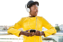 Young Woman Listening To Music On Smartphone