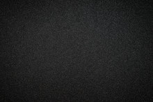 Metallic Glitter Black Background, Close Up. Dark Gray Paper Backround. Black Glitter Background From Wrapping Paper.