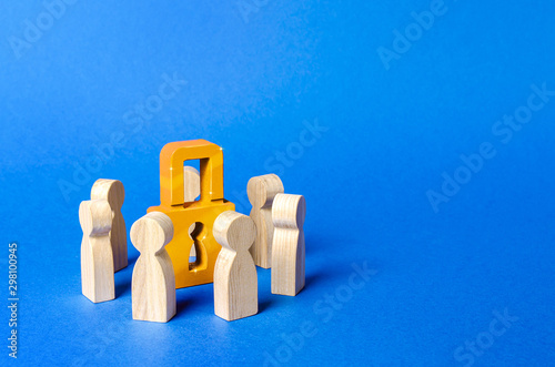 Figurines of people surround a golden padlock Canvas Print