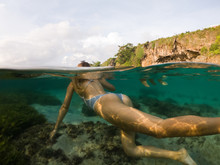 Swimming Woman Underwater In O...