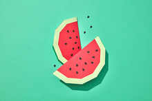 Two Mouth-watering Slices Of Red Watermelon With Seeds On A Green Background With Space For Text. Paper Handcraft Composition. Flat Lay