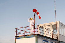 Astronaut Looking At Distance Near Windsock