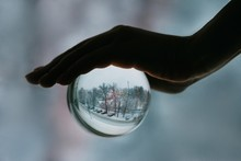 Crop Hand Holding Sphere With ...