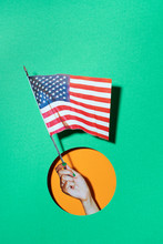Hand Holding A Usa Flag