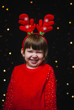 Toddler Girl Portrait With Christmas Reindeer Antlers
