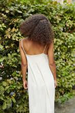 Back View Of A Black Lady.