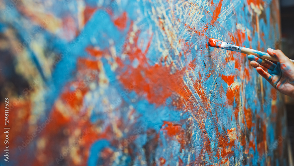 Fototapety, obrazy: Close-up Shot of Female Artist Hand, Holding Paint Brush and Drawing Painting with Red Paint. Colorful, Emotional Oil Painting. Contemporary Painter Creating Modern Abstract Piece of Fine Art