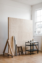 Corner Of Photography Studio With Rolling Plywood Backdrop, Seamless Papers And Utility Cart