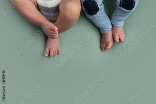 Fotografie, Tablou  feet of twins newborns, brother and sister, multiple pregnancy.