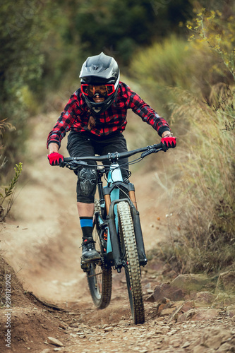 Woman riding on bike in forest