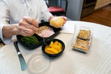 Meal: Woman Eating Volunteer Delivered Dinner