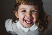 Laughing Toddler Girl Looking ...