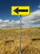 Yellow Arrow Sign With Blue Sky