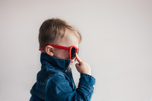 Toddler Adjusts His Sunglasses