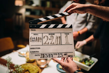 Hand Holding A Clapperboard Du...