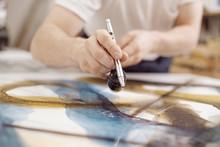 Closeup Of Man Using Airbrush While Painting