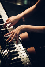 Anonymous Woman Playing Piano