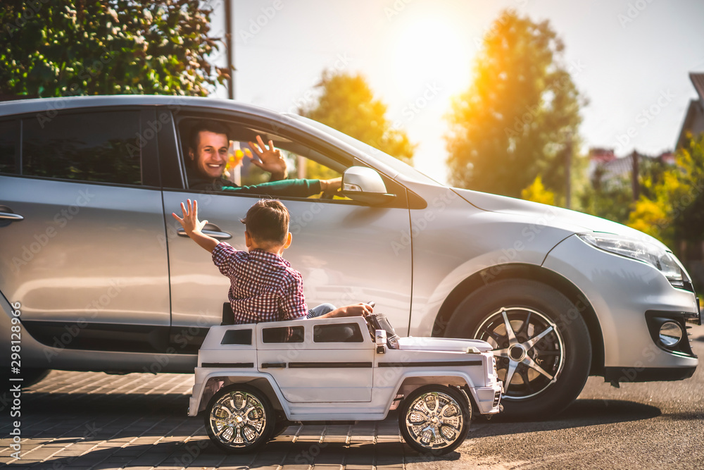 Fototapety, obrazy: The father and his little son driving their cars
