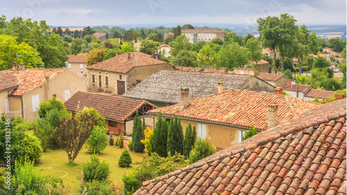 Foto auf Gartenposter Orange Summer city landscape - view of the roofs of houses in a provincial French town, in the historical province Gascony, the region of Occitanie of southwestern France