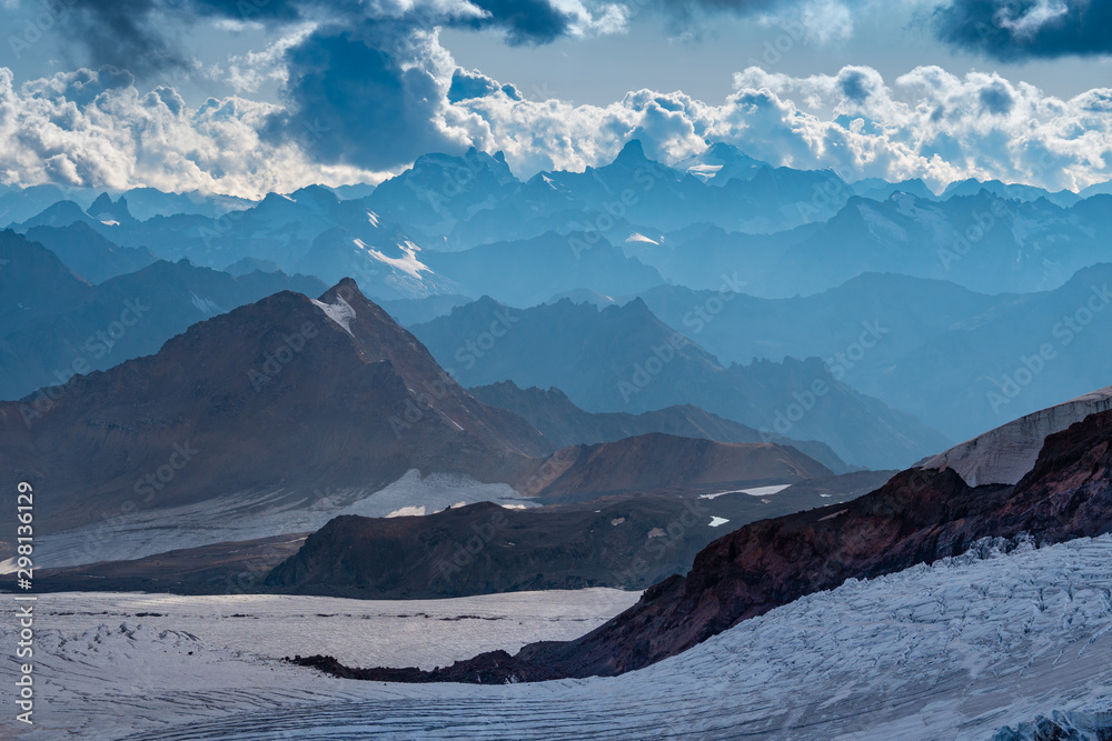 Fototapety, obrazy: Cloudy sunset in the Caucasian mountains
