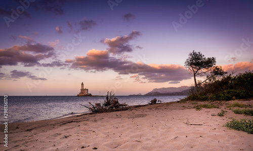 Olbia, Lido del Sole, in the background lighthouse of the Isola Bocca, Sardinia, Fotobehang
