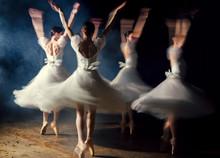 Ballerinas In Dresses Whirling On Scene In Darkness In Fog