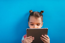 Cute Girl Using A Tablet