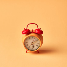 Yellow Retro Vintage Old Alarm Clock With Bells On A Pastel Yellow Background, Place Fot Text.